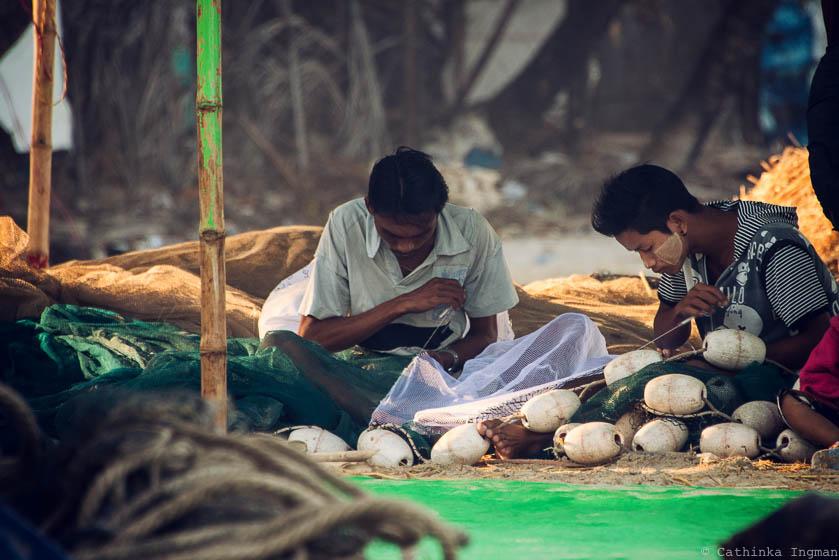 Net menders in Ngapali, Burma
